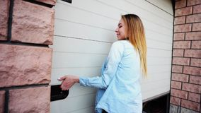 Young female person opening garage door with keys.r stock images