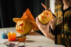 Carving a jack`o`lantern royalty free stock photo