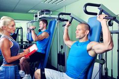 Female personal fitness trainer with two Athlete m Stock Image