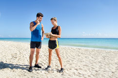 Female personal trainer at the beach. Young female personal trainer at the beach Stock Photos