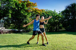 Female personal trainer at the park. Young female personal trainer at the park Stock Images