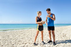 Female personal trainer. Young female personal trainer at the beach Stock Photos