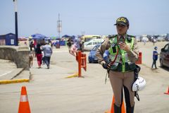 Female Peruvian traffic police officer at Costa Verde stock images