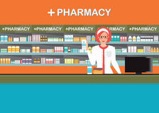 Female pharmacist at the counter in a pharmacy shop.2 Stock Images
