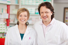 Female Pharmacist With Coworker In Pharmacy Royalty Free Stock Photography