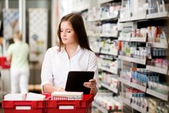Female Pharmacist with Digital Tablet Royalty Free Stock Images