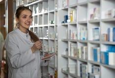 Female pharmacist  in drugstore Stock Image