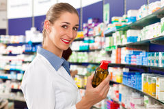 Female pharmacist in her pharmacy Stock Image