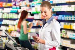 Female pharmacist in her pharmacy stock photo
