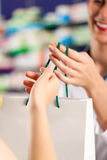 Female pharmacist in her pharmacy with a customer Royalty Free Stock Image