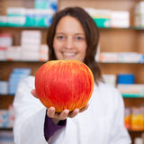 Female Pharmacist Holding Artificial Apple Stock Images