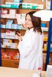 Female Pharmacist Holding Medicine Bottle Royalty Free Stock Image