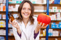 Female Pharmacist Holding Pill Bottle And An Artificial Apple Stock Image