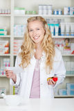 Female Pharmacist Holding Prescription Paper And Pill Bottle Royalty Free Stock Photos