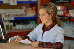 Female pharmacist holding prescription Stock Photo