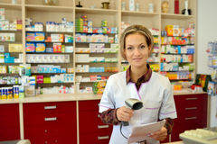 Female pharmacist holding prescription Royalty Free Stock Image