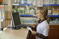 Female pharmacist holding prescription Stock Photography