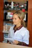 Female pharmacist holding prescription Stock Images