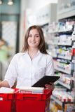 Female Pharmacist Holding Tablet PC royalty free stock image