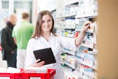Female Pharmacist Holding Tablet PC Stock Images