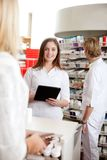 Female Pharmacist Holding Tablet Pc Stock Photography