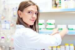 Female pharmacist presenting natural medicine Stock Photo