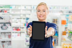 Female Pharmacist Showing Digital Tablet With Royalty Free Stock Photography