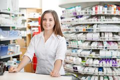 Female Pharmacist Standing at Counter stock photo