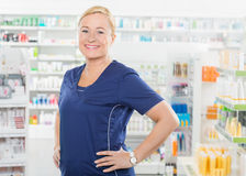 Female Pharmacist Standing With Hands On Hip In Stock Image