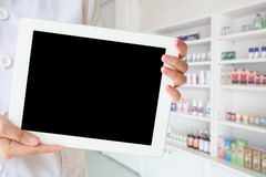Female pharmacist using tablet pc Royalty Free Stock Image