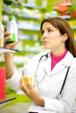 Female pharmacist working with medicine in pharmacy Royalty Free Stock Photography