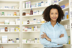 Female pharmacist working in UK pharmacy royalty free stock photography