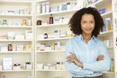 Female pharmacist working in UK pharmacy Royalty Free Stock Photography
