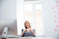 Female photo editor drinking coffee Stock Photos
