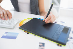 Female photo editor using graphics tablet Stock Images