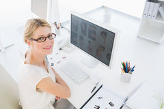 Female photo editor working on computer Royalty Free Stock Photo