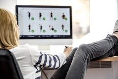 Female photo editor working on computer Stock Image