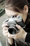 Female photographer. Caucasian woman taking pictures with an old medium format film camera stock images
