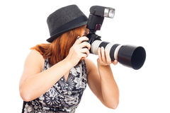 Female photographer in action Stock Photo