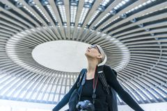 A female photographer admiring a circular concert hall ceiling royalty free stock image