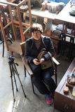 Female photographer in the antique shop Royalty Free Stock Image