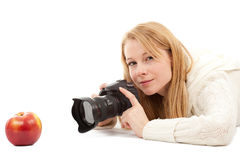 Female photographer with apple Royalty Free Stock Images