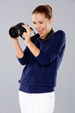 Female photographer assessing her shot Royalty Free Stock Photography