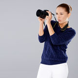 Female photographer assessing her shot Royalty Free Stock Photo