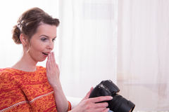 Female Photographer an being amused.  Royalty Free Stock Photos