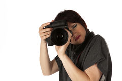 Female Photographer With Camera. Attractive Young Female Photographer In Studio On White Isolated Background Stock Photography