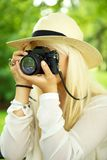 Female photographer with a camera Royalty Free Stock Image