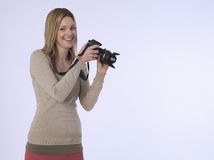 Female Photographer With Camera In Studio Stock Images