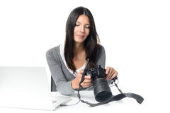 Female photographer checking an image on a camera Stock Images