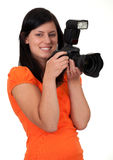Female photographer with digital camera Stock Photo
